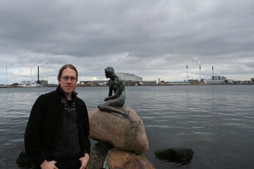 Me in front of the The Little Mermaid statue (and some industry in the back)