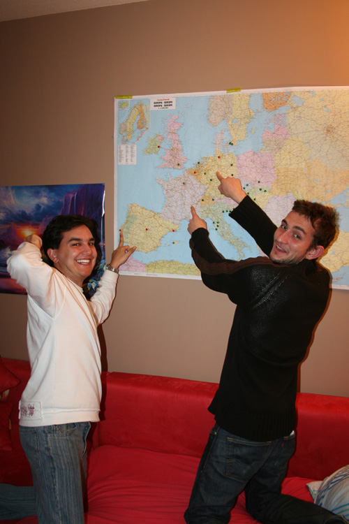 Mike and Benoît pointing where they are from and live now
