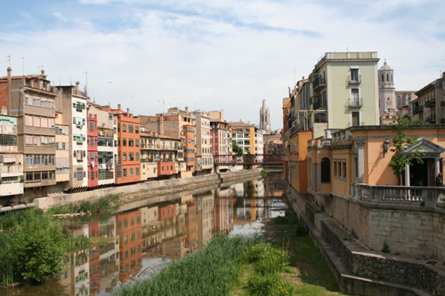 "Here a picture of the skyline of Girona and the river ""Onyar"""