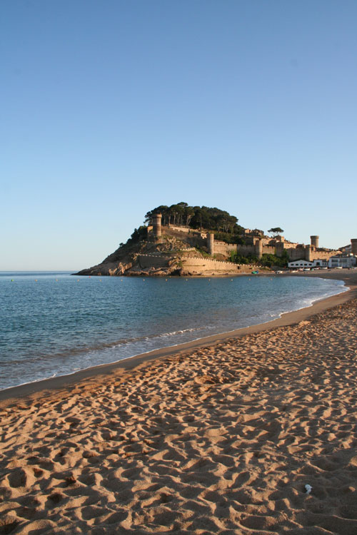 The beach and city wall of Tossa